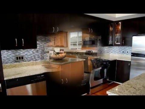 backsplash glass tile brown with brown cabinets   Colonial Gold, granite,  countertops, glass tile, backsplash, kitchen