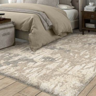 The Looking Glass rug adds romance to a living room with an impressionistic  floral pattern