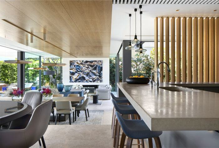 Wicker chairs near  the wooden countertop of