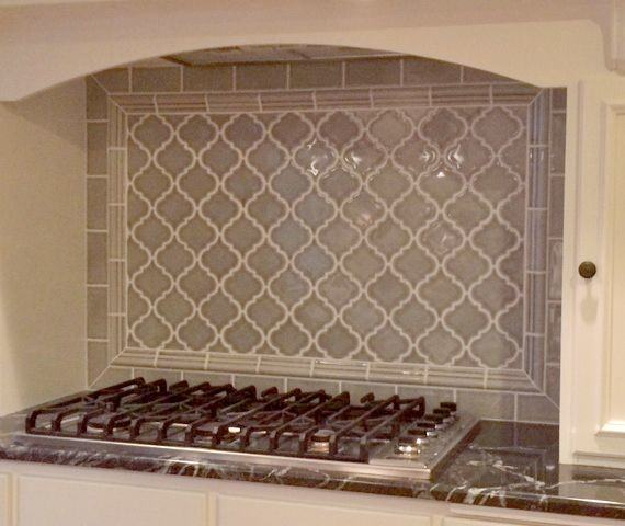 glass tile backsplash behind stove contrasting tile blue green penny tile  behind hood with white subway