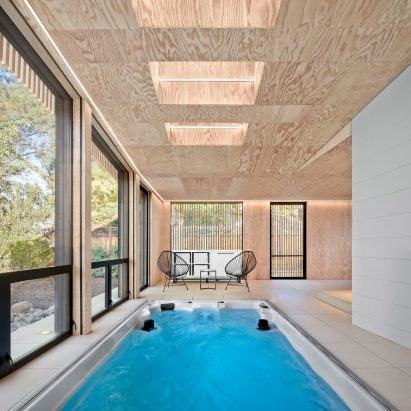 Stylish indoor pool is visually connected with the pool outside