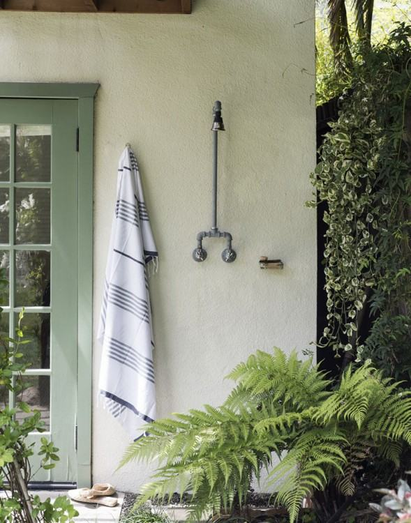 Simple materials provide privacy quickly and inexpensively in this outdoor  shower