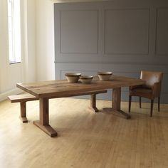 An Arts and Crafts limed oak dining set consisting of a Tilden dining  table