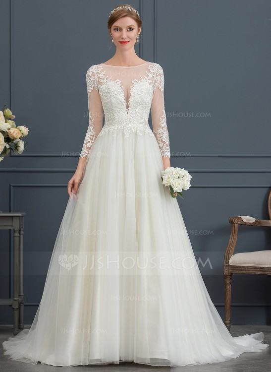 A beautiful tulle wedding dress with illusion neckline