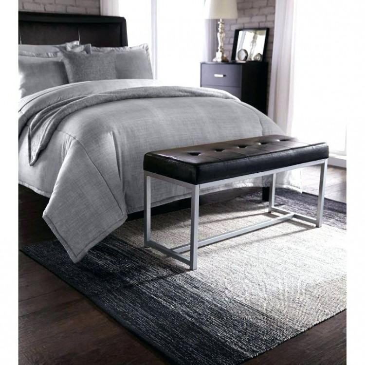 Many nice elements, black headboard, grey comforter, photos above the bed,  black nightstand and nice lamps