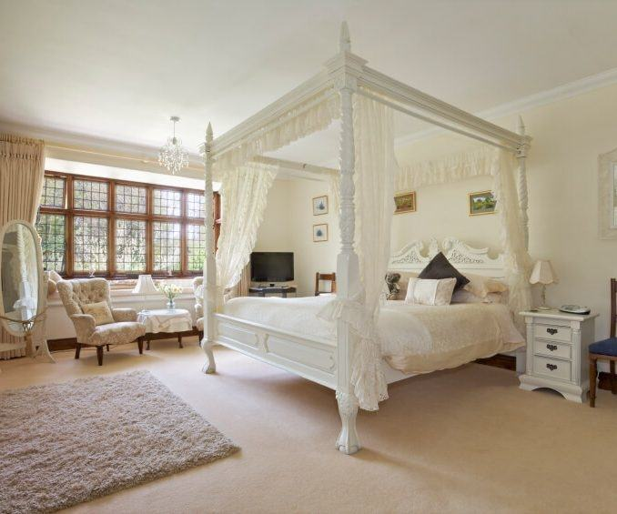 Dark wood and walls in masculine bedroom