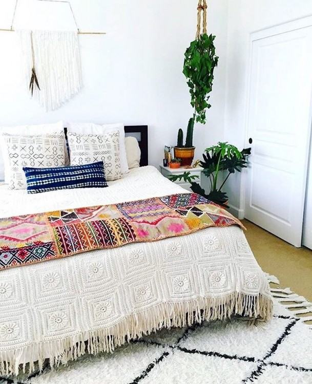 Here, the stained glass windows, exotic rug,  candles and books tie the Boho look together