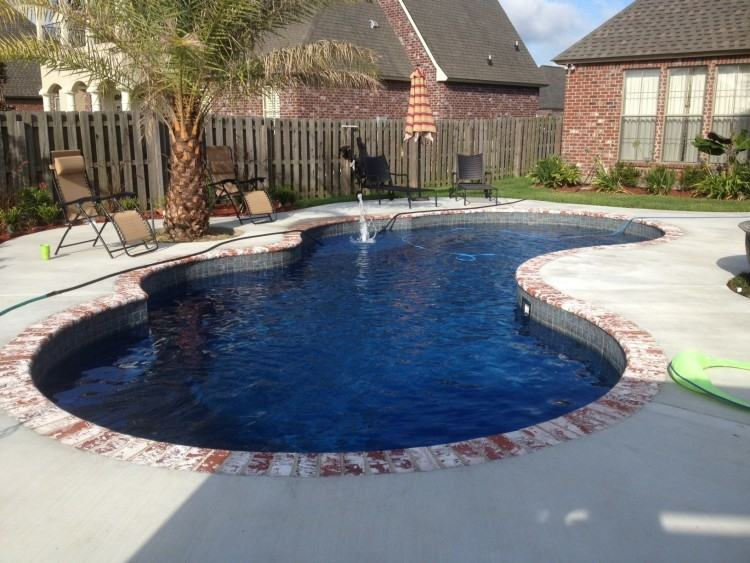 Louis brick and  Pennsylvania Blue Stone decking built by Lucas Firmin Pools in Baton Rouge,  LA