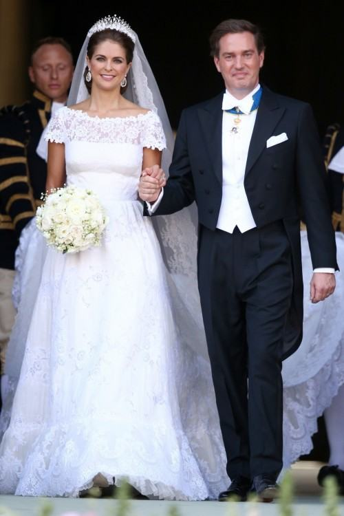 The bride wore a gown by Angel  Sanchez