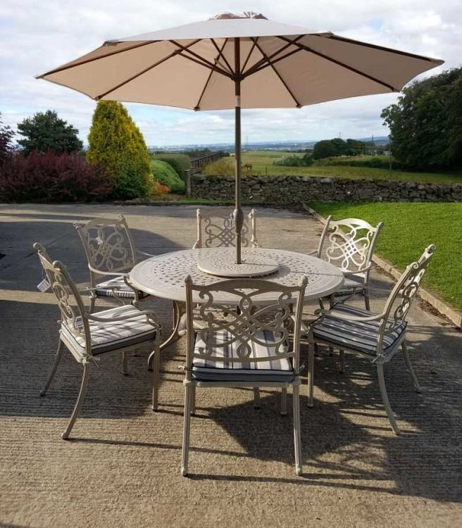 Refurbished antique patio furniture is custom fit with outdoor cushions  covered in Sunbrella fabric