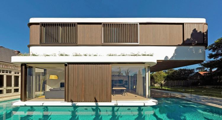 Gorgeous pool house also provides sheltered outdoor lounge and  additional space [Design: Crisp Architects