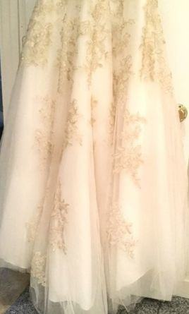 Sample Sale gowns contain imperfections such as tears in