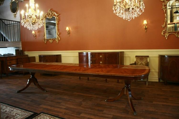 Triple Pedestal Dining Table To Seat 12 To 14 PeopleMeasures 132 inches  long by 42 inches wide