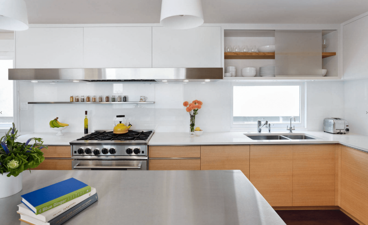 Kitchen image of white cabinets and white backsplash and stainless  appliances