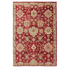 This large area rug doesn't take the eye off of the wooden floors,