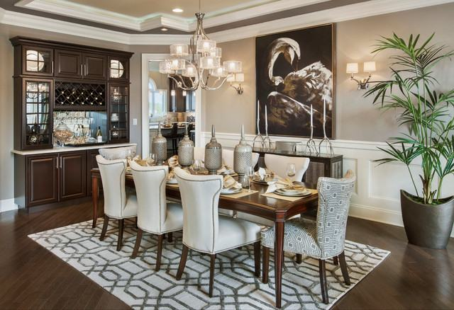 Black transitional dining room with chandelier and white chairs