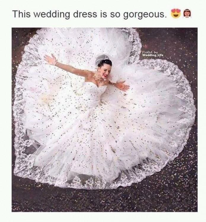 I like the wedding dress especially that heart shaped cut off at the back