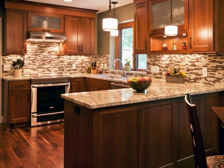 Cozy kitchen is stuffed with dark wood cabinetry, with brushed metal  hardware