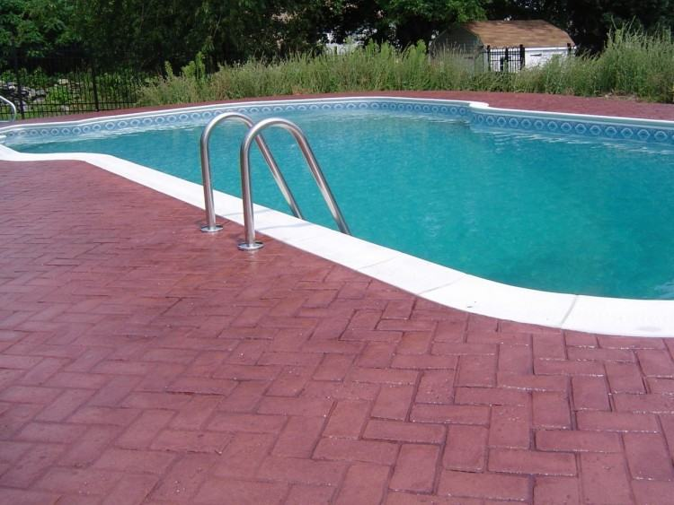 Pool deck in stamped concrete with slate skin pattern looks amazing [ Design: Sam's Outdoor