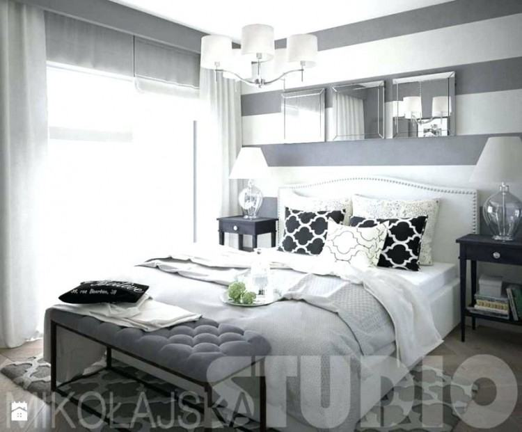 white  master bedroom with dark furniture