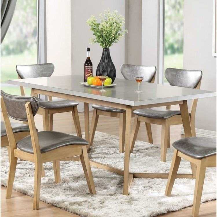 A lifestyle image of the Normandy oak extendable dining able with the  Normandy dining chairs