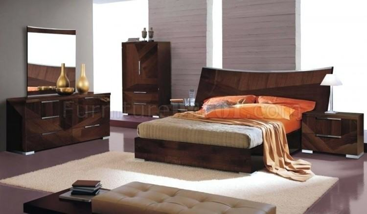 Bedroom furniture in high gloss dark walnut with high gloss cream fronts  from Harmony