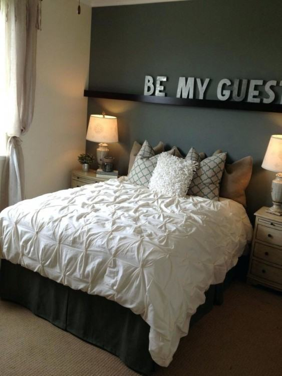 Contemporary guest bedroom idea with a dedicated workstation [Design:  Pure Style by Jerry Bussanmas